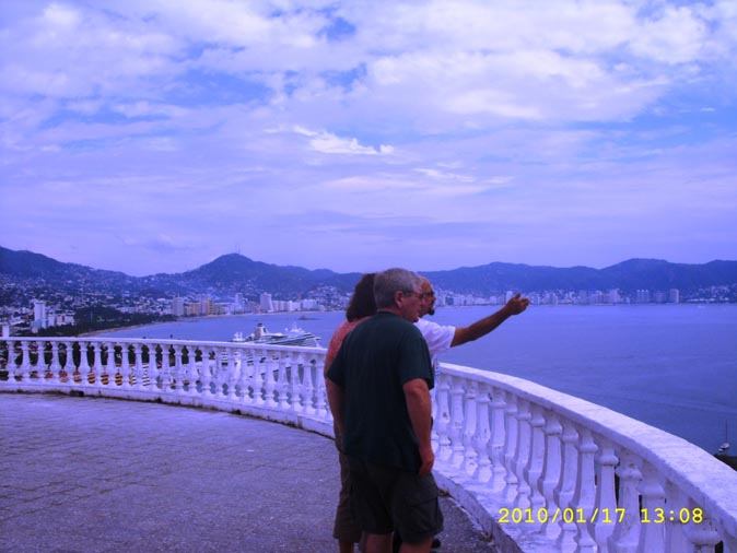 Pointing out a sight from the Casa Blanca Hotel Acapulco, accessible, advisor, agent, agents, agency, agencies, car, cars, chair, cheap, city, cruise, critic, driver, divers, españolas, events, excursion, excursions, guide, guides, Fregoso, handicapped, new, recommended, rudi, Rudy, Rodolfo, ship, sightseeing, travel, paseo, shore, shore, tourist, tourists, trip, trips, tourism, taxi, taxis, TourByVan, tour, tours, turistas, Playa, video, wheel, gira, comprehensive, incluido,