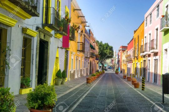 81860758-colorful-colonial-street-in-downtown-puebla-mexico.jpg